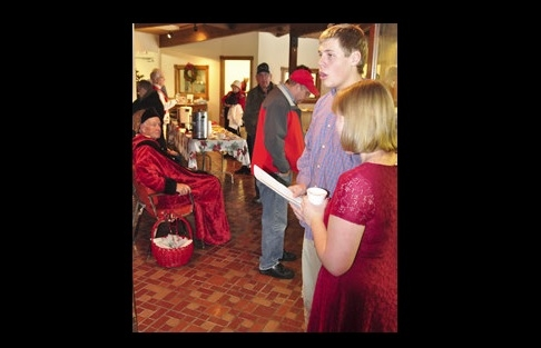 Elsa Knight and Douglas Johnson welcome guests to the 2013 Clay County Museum's historical Christmas event with music