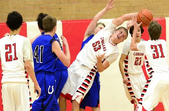 The Sandy Creek boys, with their 61-54 win over Centennial Dec. 11, combined with losses to Adams Central Dec. 9 and Friend Saturday night, are 2-4 on the season. Here, Kendall Dickson (53) and Corbin Hansen (31) maneuver for a rebound during the Cougars' win over the Broncos. Also looking on is John Sock (21) and Gabe Munoz (23).