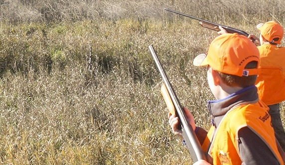 Two of the youth involved with the hunters safety course this past October, also enjoyed a youth hunt sponsored by the Rainwater Basin Pheasants Forever Chapter Oct. 18, 2014. This is just one of many programs the local PF Chapter supports each year.