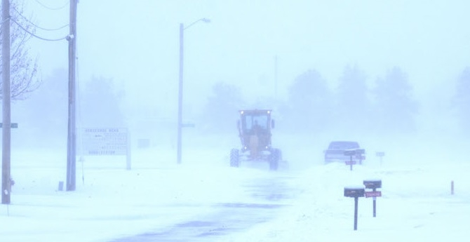 City of Sutton employee Kevin Finnegan helps Sutton dig out from nearly six inches of snow fall that hit the community and the Clay County region this past weekend. Finnegan drives this grader through the Horseshoe Bend area of Sutton Sunday morning.