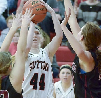 Savannah Schurman goes in for two of her nine points in the Fillies' 67-25 win over Heartland Saturday. Looking on in the background is Delaney Lemkau. Sutton improved to 13-3 with Saturday's win.