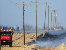 Wind fuels grass fire northwest of Grafton