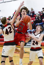 Mustangs down Cougars 55-38 in annual county clash