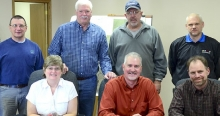 Jeff Hofaker, in the center, front, was hired Friday, Jan. 23, by the Sutton City Council to become the new City Administrator for the City of Sutton. Pictured with Hofaker in front is City Clerk Sherrie Bartell and Sutton Mayor Todd Mau. In the back are councilmen Larry T. Nuss, Dave Plettner, Jeff Schelkopf and Jon Pedersen