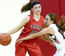Sutton's Kailyn Wiseman reaches to deflect the ball from Friend's Jackie Ries during the Fillies' win Friday. Wiseman would score 18 points on the night.