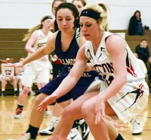 Sutton's Delaney Lemkau drives past a Fillmore Central during Thursday night's 61-24 C2-3 Sub-District title win over the Lady Panthers.